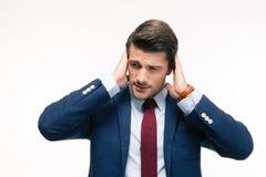 Όμορφος επιχειρηματίας που καλύπτει τα αυτιά του Στοκ Φωτογραφίες