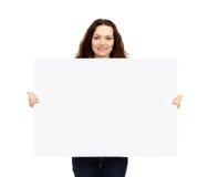 Όμορφος επιχειρηματίας που κρατά μια μεγάλη αφίσα για τη διαφήμιση των σημαδιών στοκ φωτογραφίες με δικαίωμα ελεύθερης χρήσης