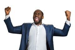 Όμορφος επιχειρηματίας που φωνάζει συναισθηματικά ναι Στοκ Εικόνες