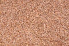Όμορφος, ζωηρόχρωμος τοίχος πετρών με τα κόκκινα τούβλα εδώ και εκεί Στοκ Φωτογραφία