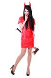 Όμορφος θηλυκός δαίμονας που κρατά ένα τσεκούρι πίσω από την πλάτη Στοκ φωτογραφία με δικαίωμα ελεύθερης χρήσης