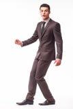 Όμορφος νέος επιχειρηματίας με την τύχη στο κοστούμι Στοκ Εικόνα