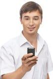 Όμορφος νεαρός άνδρας με ένα τηλέφωνο κυττάρων Στοκ Φωτογραφία