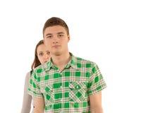 Όμορφος νεαρός άνδρας με μια ζηλότυπη φίλη Στοκ εικόνες με δικαίωμα ελεύθερης χρήσης