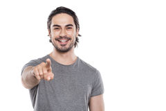 Όμορφος νεαρός άνδρας στην άσπρη ανασκόπηση Στοκ εικόνα με δικαίωμα ελεύθερης χρήσης