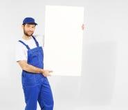 Όμορφος οικοδόμος με το λευκό πίνακα στοκ εικόνα με δικαίωμα ελεύθερης χρήσης