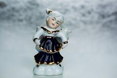 Όμορφος παλαιός άγγελος πορσελάνης που απομονώνεται στο λευκό Στοκ Εικόνα