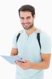 Όμορφος σπουδαστής που χρησιμοποιεί το PC ταμπλετών του Στοκ Εικόνες