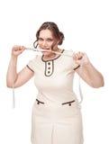 Όμορφος συν το ροκανίζοντας εκατοστόμετρο γυναικών μεγέθους Στοκ φωτογραφία με δικαίωμα ελεύθερης χρήσης