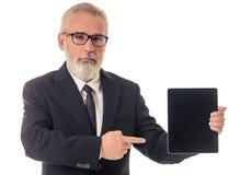 Όμορφος ώριμος επιχειρηματίας με τη συσκευή Στοκ Εικόνα