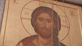 Όμορφο εικονίδιο στον τοίχο της χριστιανικής εκκλησίας με την εικόνα του Ιησούς Χριστού σε το φιλμ μικρού μήκους