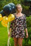Όμορφο ισπανικό πρότυπο φορώντας θερινό φόρεμα μέσα Στοκ Φωτογραφία