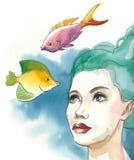 Όμορφο κορίτσι και τροπικά ψάρια Στοκ Εικόνα