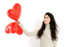 Όμορφο κορίτσι με τα κόκκινα μπαλόνια Στοκ Εικόνα