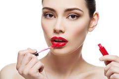 Όμορφο κορίτσι με τα lipgloss Στοκ φωτογραφία με δικαίωμα ελεύθερης χρήσης