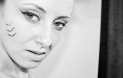 Όμορφο κορίτσι με το φυλετικό makeup Στοκ φωτογραφία με δικαίωμα ελεύθερης χρήσης