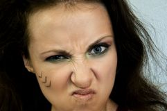 Όμορφο κορίτσι με το φυλετικό makeup Στοκ εικόνες με δικαίωμα ελεύθερης χρήσης