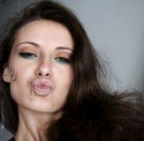 Όμορφο κορίτσι με το φυλετικό makeup Στοκ Φωτογραφία