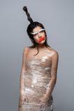 Όμορφο κορίτσι με το applique στο πρόσωπο Στοκ Φωτογραφίες