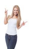 Όμορφο κορίτσι που παρουσιάζει κάτι στοκ εικόνα με δικαίωμα ελεύθερης χρήσης