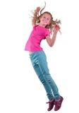 Όμορφο κορίτσι που πηδά και που χορεύει πέρα από το λευκό στοκ φωτογραφία