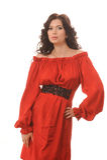 Όμορφο κορίτσι σε ένα κόκκινο φόρεμα σε ένα άσπρο υπόβαθρο. στοκ εικόνες