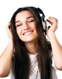 Όμορφο κορίτσι στα ακουστικά Στοκ εικόνα με δικαίωμα ελεύθερης χρήσης