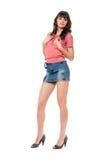 Όμορφο κορίτσι στη μίνι φούστα τζιν Στοκ εικόνες με δικαίωμα ελεύθερης χρήσης