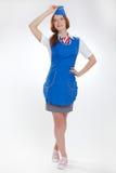 Όμορφο κορίτσι στις μπλε στολές στοκ φωτογραφία