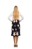 Όμορφο κορίτσι φούστα με τα λουλούδια που απομονώνεται στη μαύρη Στοκ Εικόνες