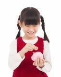 Όμορφο μικρό κορίτσι με τη piggy τράπεζα Στοκ εικόνες με δικαίωμα ελεύθερης χρήσης