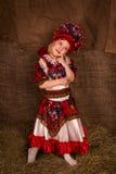 Όμορφο μικρό κορίτσι στο εθνικό κοστούμι Στοκ Εικόνα