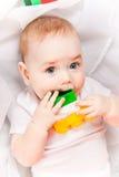 Όμορφο μωρό με τα παιχνίδια Στοκ φωτογραφίες με δικαίωμα ελεύθερης χρήσης