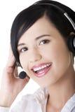 Όμορφο νέο κλήση-κεντρικό βοηθητικό χαμόγελο Στοκ Εικόνες