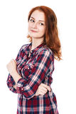 Όμορφο νέο κοκκινομάλλες κορίτσι που κοιτάζει στην πλευρά Στοκ εικόνα με δικαίωμα ελεύθερης χρήσης