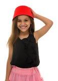 Όμορφο νέο κορίτσι με το όμορφο χαμόγελο που φορά ένα Fez Στοκ Εικόνες