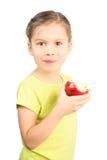 Νέο κορίτσι που τρώει τη Apple Στοκ Εικόνες