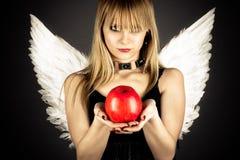 Νέο κορίτσι στο ρόλο να βάλει στον πειρασμό τον άγγελο Στοκ Φωτογραφίες
