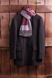Όμορφο παλτό με ένα μαντίλι Στοκ Φωτογραφία