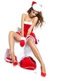 Όμορφο προκλητικό κορίτσι που φορά τα ενδύματα Άγιου Βασίλη Στοκ εικόνα με δικαίωμα ελεύθερης χρήσης