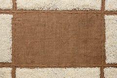 Όμορφο πλαίσιο με το ρύζι sackcloth Στοκ Φωτογραφία