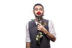 Όμορφο ρομαντικό ευτυχές άτομο με το ροδαλό λουλούδι Στοκ φωτογραφίες με δικαίωμα ελεύθερης χρήσης