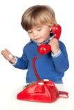 όμορφο τηλεφωνικό κόκκινο μωρών Στοκ Εικόνες