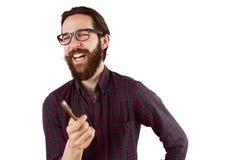 Όμορφο hipster που γελά και που δείχνει Στοκ Εικόνες