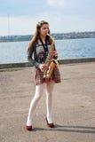 όμορφο saxophone κοριτσιών Στοκ Εικόνες