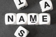 Όνομα λέξης στους κύβους παιχνιδιών στοκ εικόνες