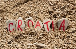 Όνομα χωρών της Κροατίας φιαγμένο από χρωματισμένες πέτρες Στοκ Εικόνα