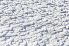 όπως η ανασκόπηση είναι μπορεί σβόλοι ιδιαίτεροι κάλυψε την επιφάνεια χιονιού ποσότητας σχεδιαστών χρησιμοποιούμενη Στοκ φωτογραφία με δικαίωμα ελεύθερης χρήσης