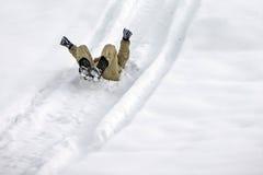 Όλοι στο λευκό, που γλιστρά στο χιόνι Στοκ εικόνα με δικαίωμα ελεύθερης χρήσης