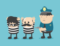 Δύο ληστές που συλλαμβάνονται από την αστυνομία Στοκ φωτογραφία με δικαίωμα ελεύθερης χρήσης